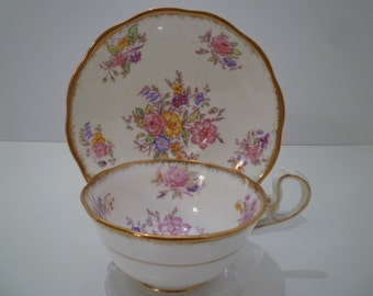 ROYAL ALBERT TEACUP Set. Vintage 1950's Royal Albert Teacup and Saucer. English Country Garden Floral Bouquets Design.