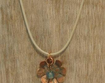 Etched copper pendant