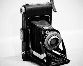 "10"" x 10"" Black and White Photograph of a Vintage Kodak Film Camera"