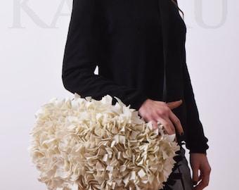 cream and black felt bag woven handles and shoulder strap