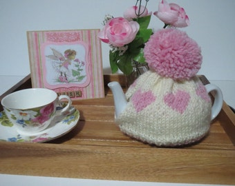 Hand knitted heart teacosy