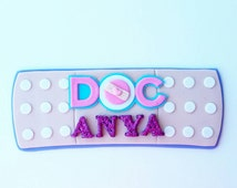 Doc Mcstuffins band aid cake topper.  Band aid cake topper.