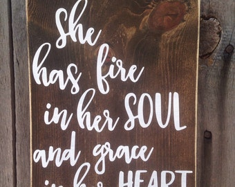 She has fire in her soul and grace in her heart wall sign handwritten font