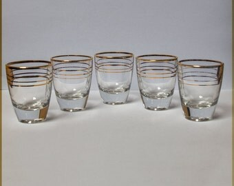 Small glasses with golden stripes  France  Liquor  Vodka  Fifties