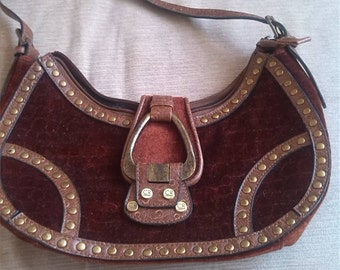 A charlotte reid velvet baguette bag  with leather trims and handle with a metal snap close buckle
