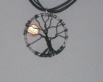 black and orange tree of life pendant