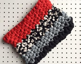 Crochet clutch bag in red + white + black + grey chunky effect yarn