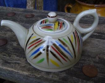 Miniature porcelain teapot
