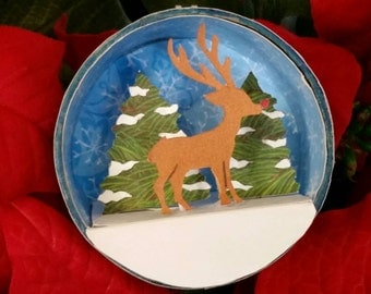 Handmade Christmas Ornament: Reindeer in the forest. Cut paper shadow box