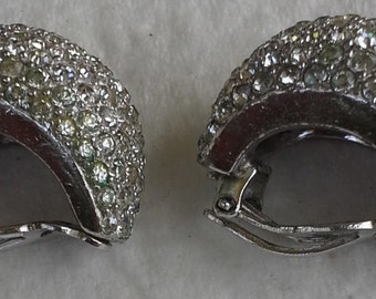 Jomaz pair of clip on earrings with rhodium plated and clear rhinestones