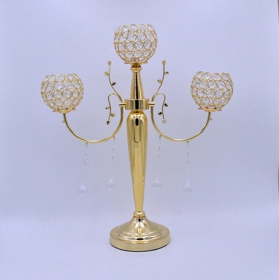 Gold arms crystal candelabra floral riser wedding