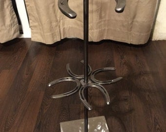 Two tiered Spinning Horseshoe Necklace Stand with pony shoes