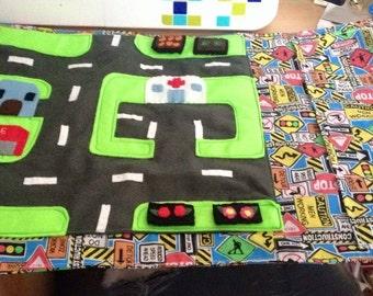 Roll away road mat
