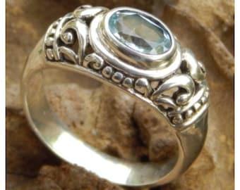 Silver ring blue topaz stone