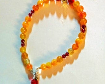 Beautiful handmade amber and red crystal racelet