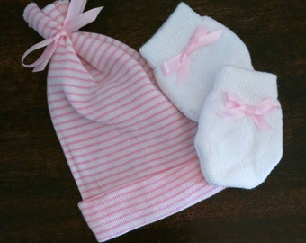 EXCLUSIVE! Newborn Hospital Hat tied at top with cute bow and Baby Mittens with matching pink bows! Cute and a Great Gift! Only found here!