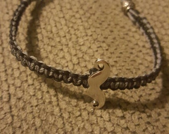 Mustache charm bracelet with bead/loop clasp