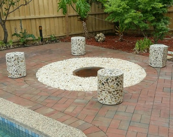 4 piece set of fire pit seating.  Polished concrete, solid outdoor ottomans.