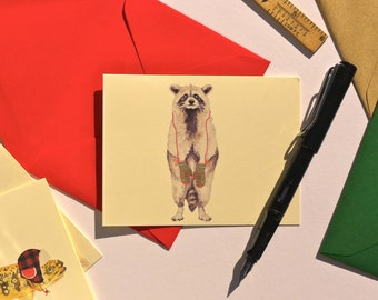 Raccoon warm in mittens folded note card with your choice of envelope color.