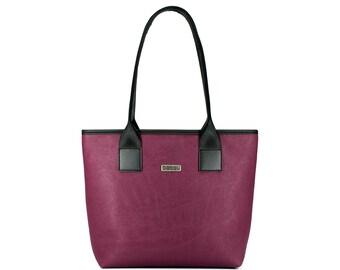 Plum tote bag with light inside. 9 pockets.