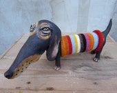 Ceramic dachshund in a hand knitted striped sweater