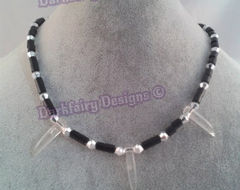 Beaded necklace with clear fangs