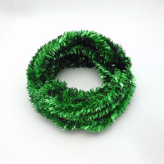 Roll of metallic emerald green wired tinsel garland