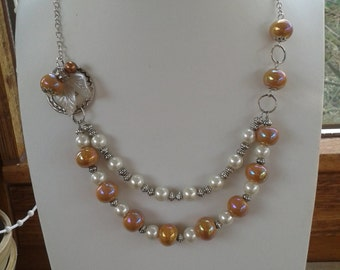 Double necklace with ceramic beads