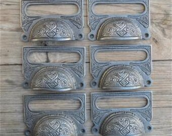 A set of 10 large Edwardian cast iron label frames CB10