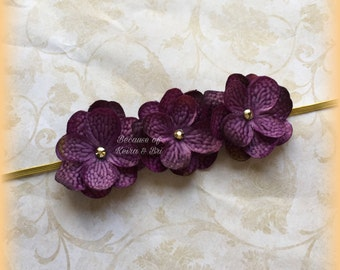 Dark purple flowers with gold headband