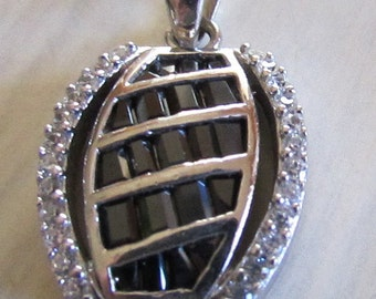Sterling Silver with Faceted Black and Clear Stones Pendant