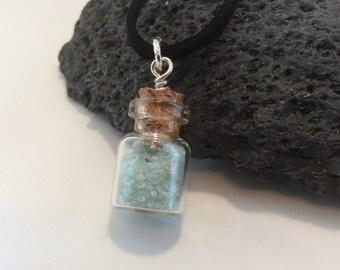 birthstone bottle of gems - march - aquamarine