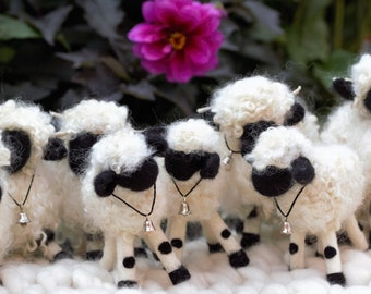 Needle felted Valais Blacknose sheep.  https://theblacknosesheep.com/collections/all
