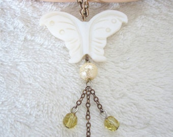 "Mother Of Pearl Carved Butterfly Pendant-suspended on a 16""copper-tone chain with citrine & pink crystal glass beads.A great gift for women!"