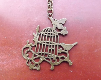 Bird cage necklace.
