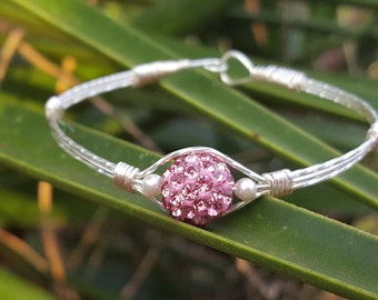 Handmade Wire Wrapped Bracelet using non tarnish silver/gold plated wire, a pink Swarovski pave crystal, & 2 small white Swarovski pearls