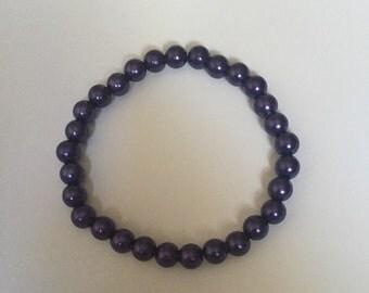 Purple beaded bracelet.