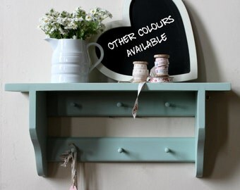 Shakers shelf with a double rail of pegs, solid pine