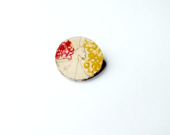 Pink and mustard hand painted wooden brooch.
