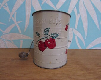 circa. 1940s Bromwell's 3-cup flour sifter, red apple motif