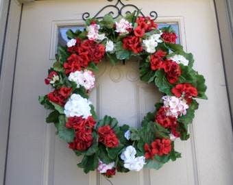 Full spring/summer geranium wreath in red, white, and variegated colors
