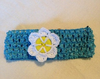 Light blue stretchy headband with with button flower
