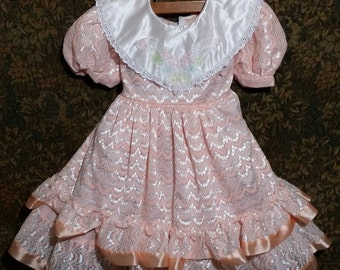Little girl peach 80's vintage special occasion dress of quality,  large rows of lace hemline.