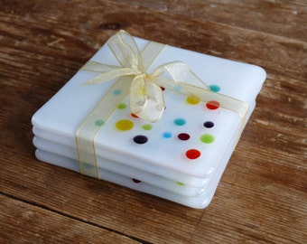 Handmade Glass Coasters. Set of four,multi-coloured dotty design. Designed and made in the UK.