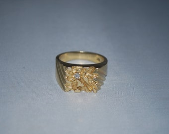 14K gold ring size 9.5 with diamond.  11.4 grams