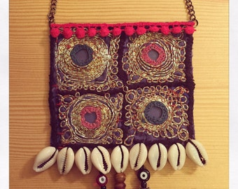 Ethnic embroidered long necklace.