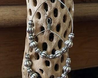Silver chandelier earrings.