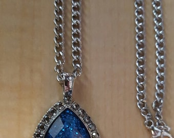 Approx. 26 inch Deep blue sapphire like stone on a silver chain