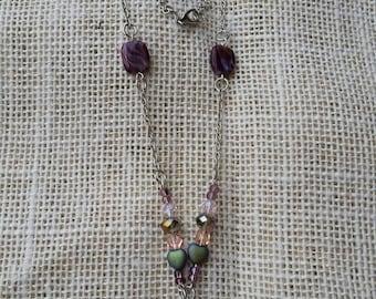 Purple and pink heart locket