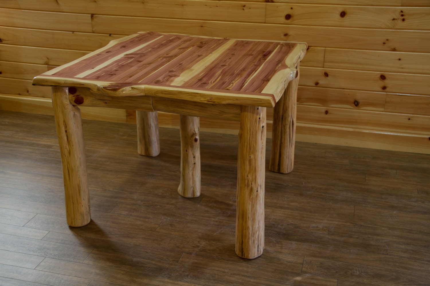 Rustic red cedar log extension dining table with leaves